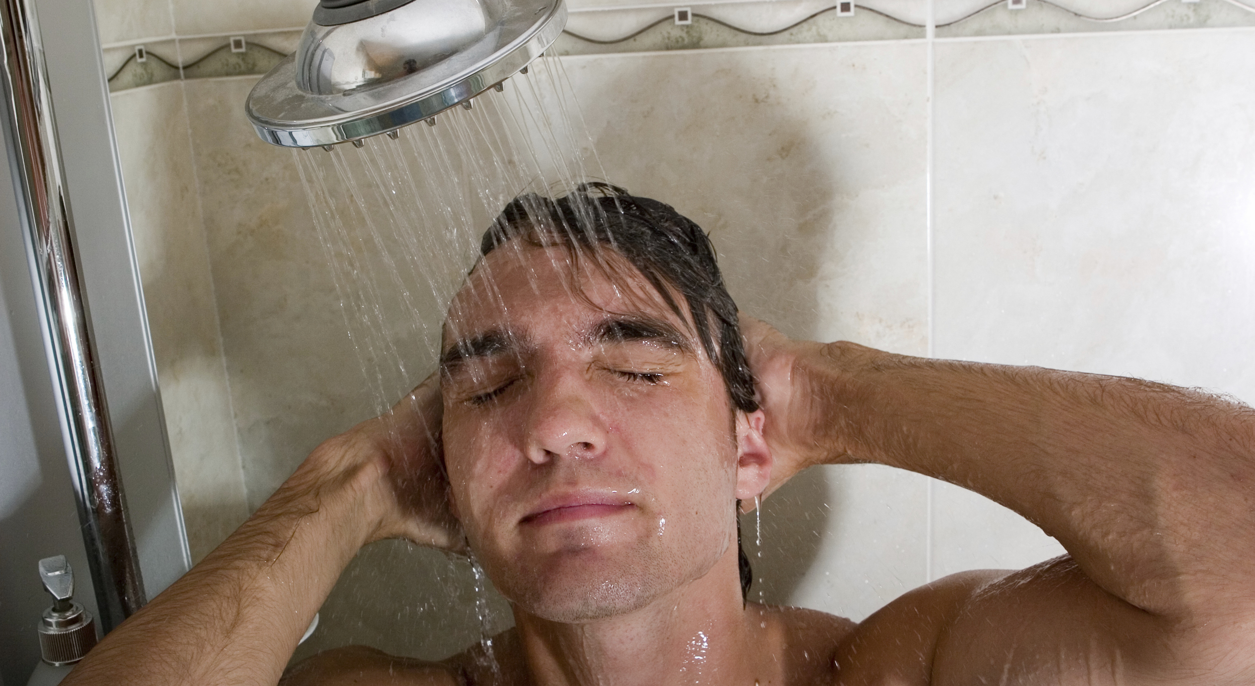 a-young-man-taking-shower-also-available-2